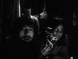 Fig. 6. Guevara and his friends filming scrambled television footage in <em>Funeral Parade of Roses</em>.