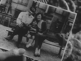 Fig. 8. Eddie burns a family photograph in Funeral Parade of Roses.